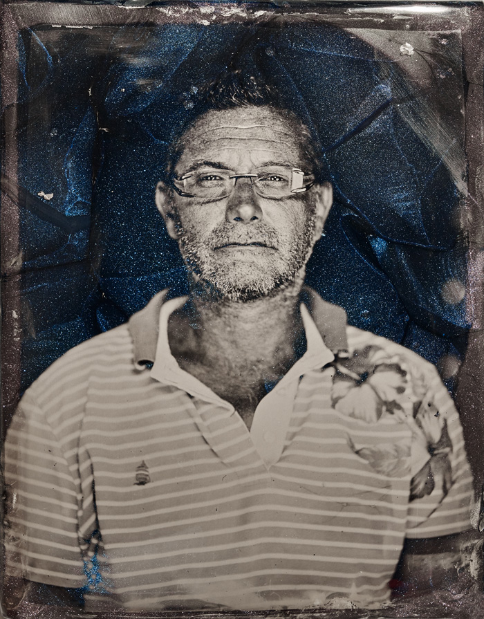 "Marcin Gierat, Portrait of Massimiliano Schiavon, CEO Schiavon Art Team, 2019. Wet Collodion photography on Murano glass ""Avventurina"". 21.5x27.5 cm. Courtesy of the artist and Zuecca Projects, Venice"